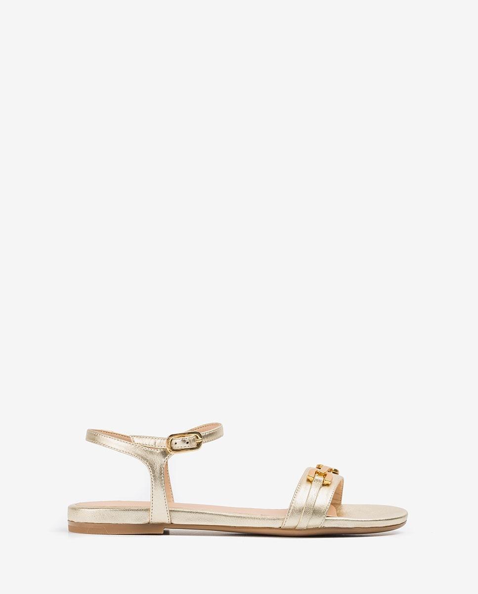 Flache goldene Sandalen